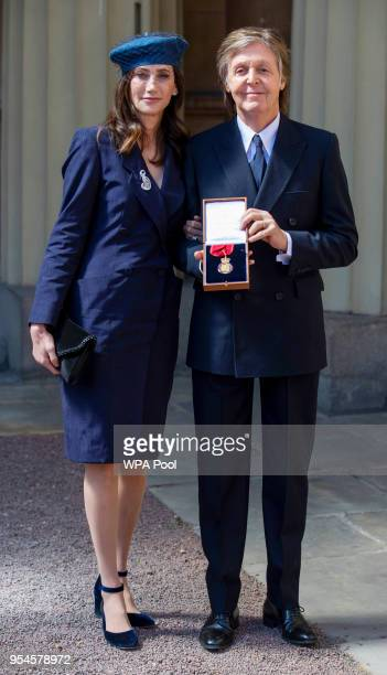 Sir Paul McCartney and his wife Nancy Shevell following an Investiture ceremony where he was made a Companion of Honour at Buckingham Palace on May 4...