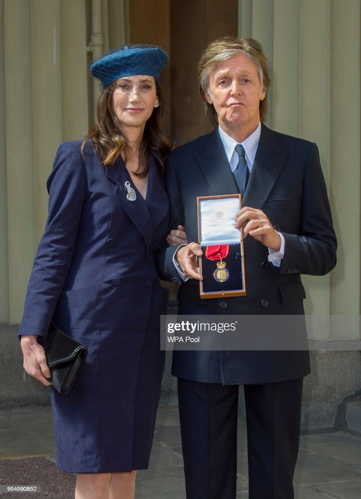 Sir Paul McCartney and his wife Nancy Shevell pose following an Investiture ceremony, where he was made a Companion of Honour at Buckingham Palace on May 4, 2018 in London, England.