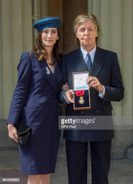 Sir Paul McCartney and his wife Nancy Shevell pose following an Investiture ceremony where he was made a Companion of Honour at Buckingham Palace on...