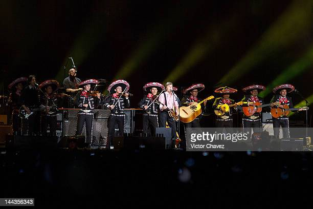 Sir Paul McCartney and mariachi Gama Mil perform a free concert celebrating the mother's day at Zocalo on May 10 2012 in Mexico City Mexico