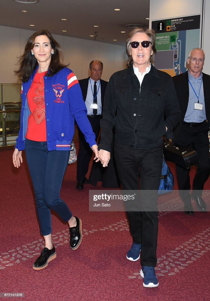 Sir Paul McCartney And Nancy Shevell Are Seen Upon Arrival At Haneda Airport On April 23