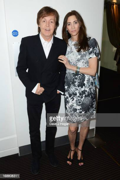 Sir Paul McCartney and Nancy Shevell attend a screening of 'Rock Show' at BAFTA on May 15 2013 in London England