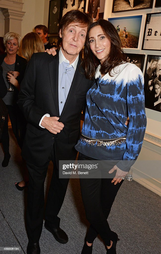 Sir Paul McCartney (L) and Nancy Shevell attend the book launch and private view of 'Mary McCartney: Monochrome And Colour' curated by De Pury De Pury on November 20, 2014 in London, England.