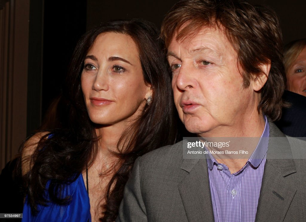 Sir Paul McCartney and Nancy Shevell attend the Stella McCartney Ready to Wear show as part of the Paris Womenswear Fashion Week Fall/Winter 2011 at Opera Garnier on March 8, 2010 in Paris, France.