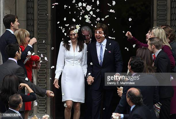 Sir Paul McCartney and Nancy Shevell leave the Marylebone Registry Office after their civil ceremony marriage on October 9 2011 in London England