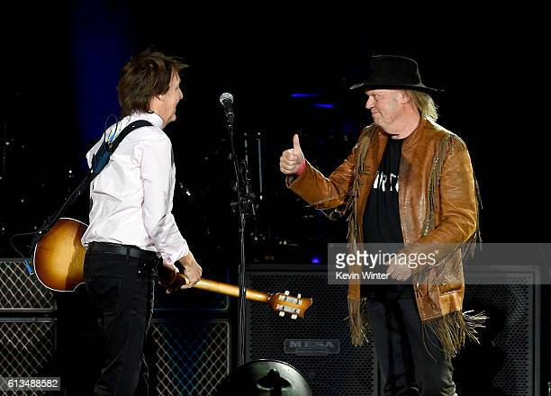 Sir Paul McCartney and Neil Young perform onstage during Desert Trip at the Empire Polo Field on October 8, 2016 in Indio, California.