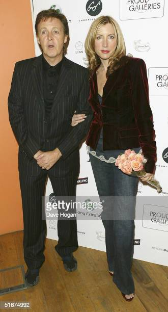 Sir Paul McCartney and wife Heather Mills McCartney attend the 'Each One Believing ' Private View of photos by US photographer Bill Bernstein of Sir...