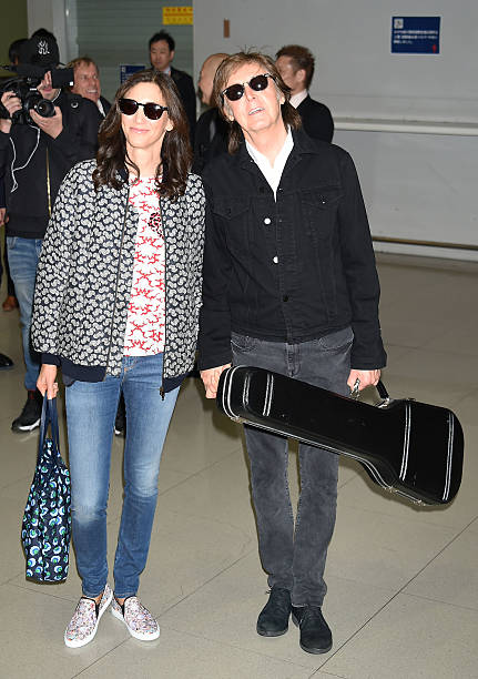 Sir Paul McCartney And Wife Nancy Shevell Are Seen Upon Arrival At Kansai International Airport On