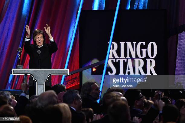 Sir Paul McCartney inducts Ringo Starr onstage during the 30th Annual Rock And Roll Hall Of Fame Induction Ceremony at Public Hall on April 18 2015...