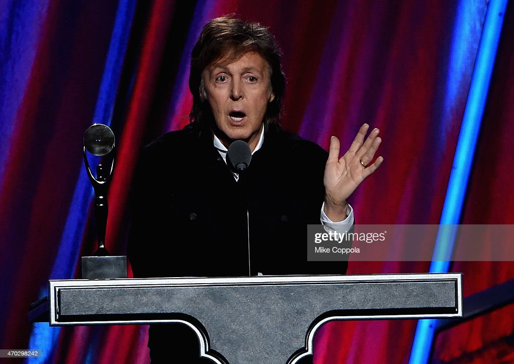 Sir Paul McCartney inducts Ringo Starr onstage during the 30th Annual Rock And Roll Hall Of Fame Induction Ceremony at Public Hall on April 18, 2015 in Cleveland, Ohio.