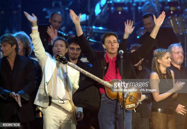 Sir Paul McCartney orchestrates the finale on stage in the gardens of Buckingham Palace for the second concert to commemorate the Golden Jubilee of...