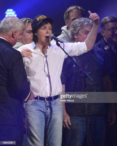 Sir Paul McCartney performs at '121212' a concert benefiting The Robin Hood Relief Fund to aid the victims of Hurricane Sandy presented by Clear...