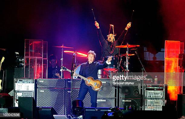 Sir Paul McCartney performs live on the main stage during day three of the Isle of Wight Festival 2010 at Seaclose Park on June 13 2010 in Newport...