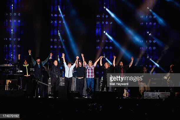 Sir Paul McCartney performs on stage with members of Nirvana at Safeco Field on July 19 2013 in Seattle Washington
