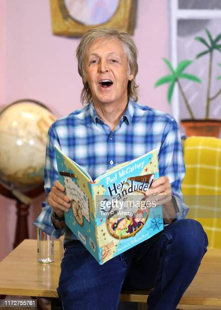 "Sir Paul McCartney poses for photograph at the ""Hey Grandude!"" book signing at Waterstones Piccadilly on September 06, 2019 in London, England."