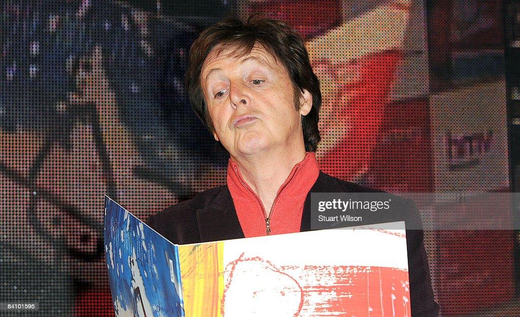 Sir Paul McCartney signs copies of his album 'Electric
