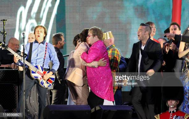 Sir Paul McCartney Sir Cliff Richard and Sir Elton John and Robbie Williams on stage at The Diamond Jubilee Concert in front of Buckingham Palace...
