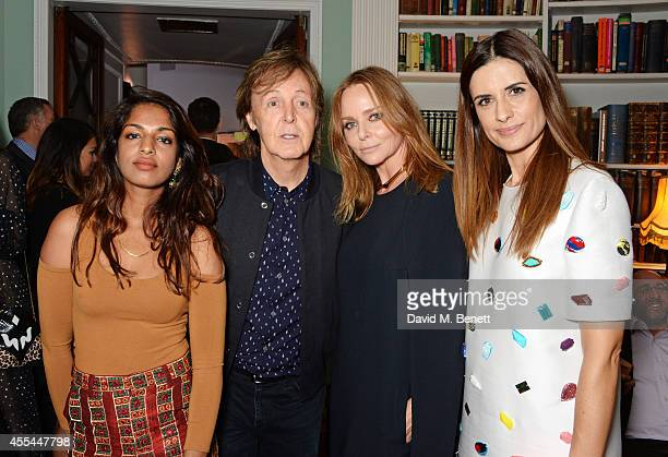 Sir Paul McCartney, Stella McCartney and Livia Firth attend The London 2014 Stella McCartney Green Carpet Collection during London Fashion Week at...