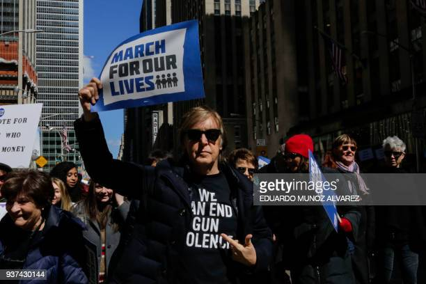 Sir Paul McCartney takes part in the March for Our Lives Rally near Central Park West in New York on March 24 2018 Galvanized by a massacre at a...