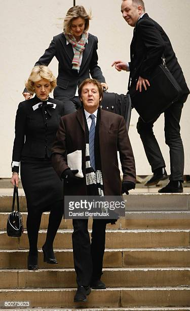 Sir Paul McCartney waves as he arrives at the High Court with his lawyer Fiona Shackleton on March 17 2008 in London England Sir Paul McCartney today...
