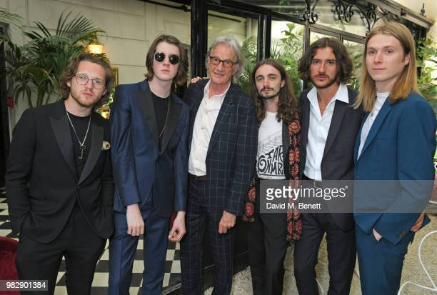 Sir Paul Smith poses with Joe Donovan Tom Ogden Josh Dewhurst Charlie Salt and Myles Kellock of Blossoms all wearing Paul Smith at the Paul Smith...