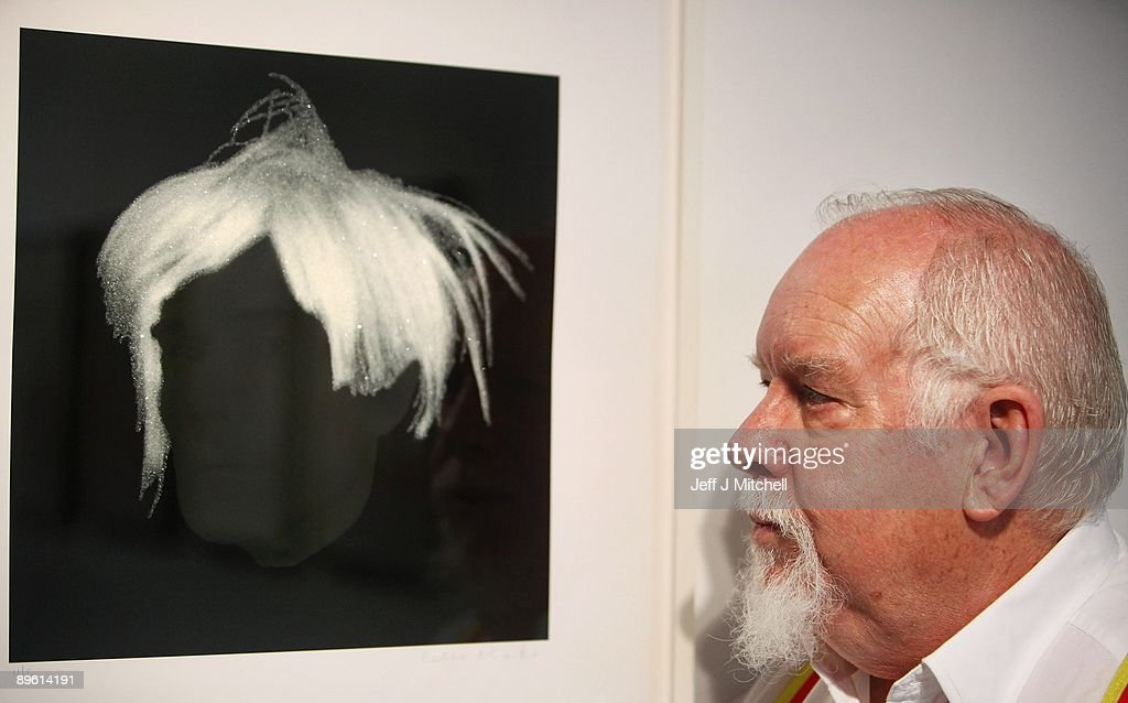 Sir Peter Blake stands with his limited edition print of Andy Warhol at the launch of Edinburgh art festival on August 5, 2009 in Edinburgh, Scotland. Established in 2004, it is Scotland�s largest visual arts festival, with works showing in many of the cities galleries and museums until September the 5th.