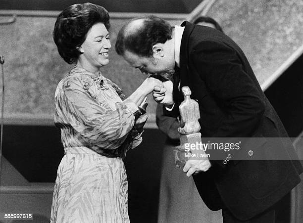 Sir Peter Hall director of the National Theatre kisses the hand of Princess Margaret after she presented him with a special award marking his 25...