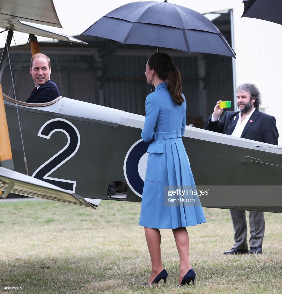 Sir Peter Jackson takes a photo of Prince William, Duke of Cambridge as Catherine, Duchess of Cambridge looks on in a plane at a WW1 commemorative and Flying Day at Omaka Aviation Heritage Centre on April 10, 2014 in Blenheim, New Zealand. The Duke and Duchess of Cambridge are on a three-week tour of Australia and New Zealand, the first official trip overseas with their son, Prince George of Cambridge.