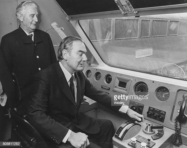 Sir Peter Parker , Chairman of British Rail, trying out the controls of an Advanced Passenger Train as driver George Clarke looks on, at Euston...