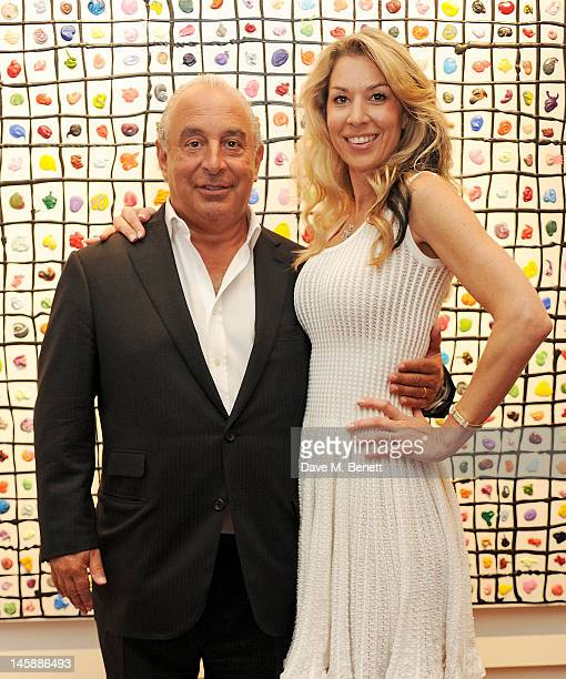 Sir Philip Green and artist Stasha Palos attend a private viewing of 'Colour: An Exhibition By Stasha', featuring works by Stasha Palos, at The...