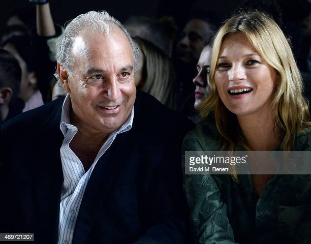 Sir Philip Green and Kate Moss attend the Topshop Unique show at London Fashion Week AW14 at Tate Modern on February 16, 2014 in London, England.