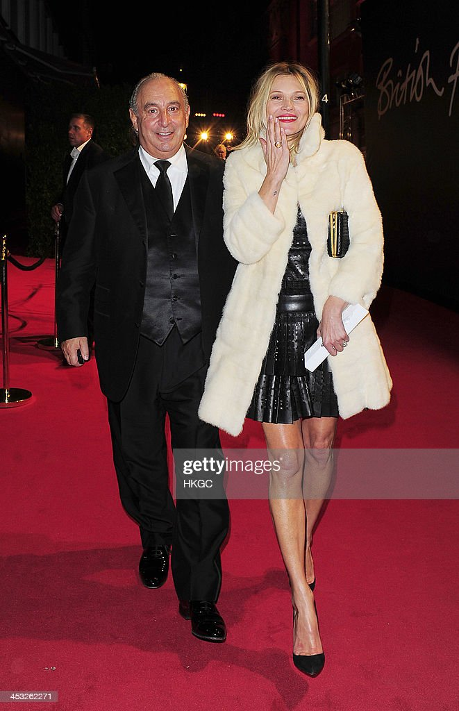 Sir Philip Green and Kate Moss leave the 2013 Fashion Awards before heading to the Playboy Member's Club in Mayfair on December 2, 2013 in London, England.