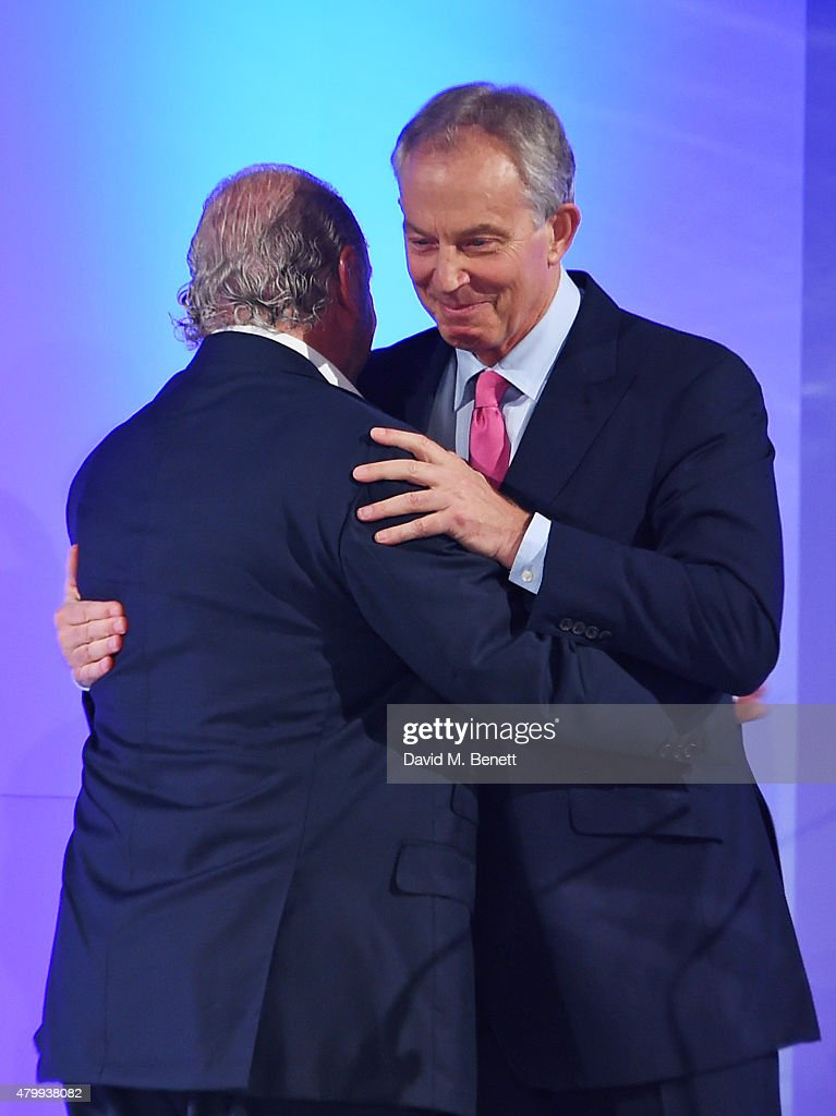 Sir Philip Green greets Tony Blair at the Fashion Retail Academy 10th Anniversary Awards at Freemasons' Hall on July 8, 2015 in London, England.