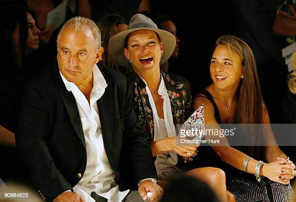 Sir Philip Green, Kate Moss and Chloe Green watch the runway during the Unique show during London Fashion Week, at P3 on September 20, 2009 in...