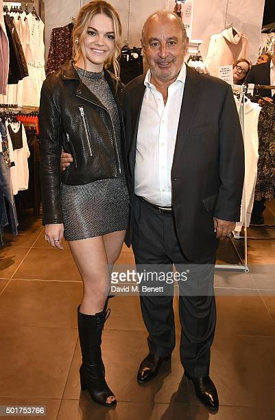 Sir Philip Green with Louisa Johnson as she visits the Topshop Oxford Circus store at TopShop on December 17 2015 in London England
