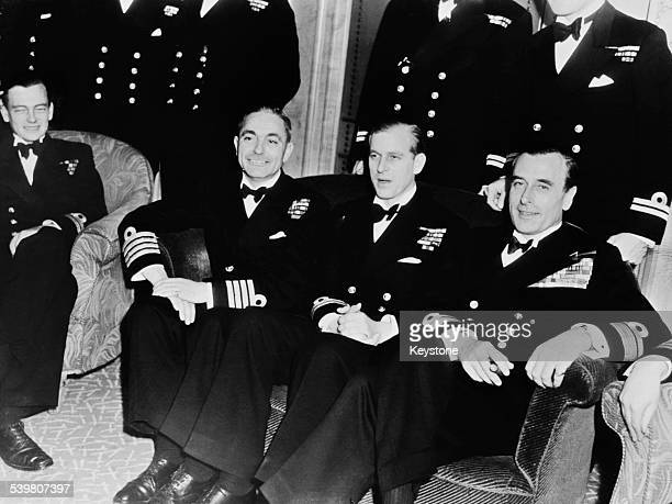 Sir Philip Mountbatten newly titled Duke of Edinburgh with fellow Royal Navy officers at his bachelor party at the Dorchester Hotel London 19th...