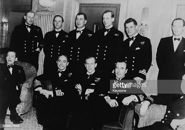 Sir Philip Mountbatten, newly titled Duke of Edinburgh with fellow Royal Navy officers at his bachelor party at the Dorchester Hotel, London, 19th...