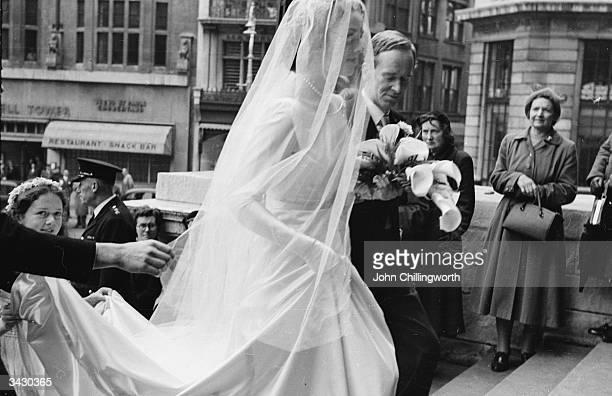Sir Pierson Dixon Deputy UnderSecretary of State for Foreign Affairs giving away his daughter Jennifer at her London wedding He was later appointed...