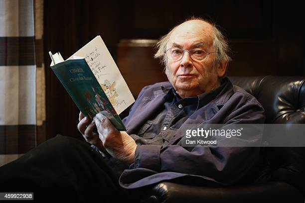 Sir Quentin Blake holds an annotated page by Quentin Blake from Roal Dahl's 'Charlie and the Chocolate Factory' at Sotheby's auction House on...