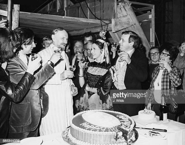 Sir Ralph Richardson is toasted by the cast and crew of the film 'A Doll's House' for his 70th birthday with actors Claire Bloom and Anthony Hopkins...