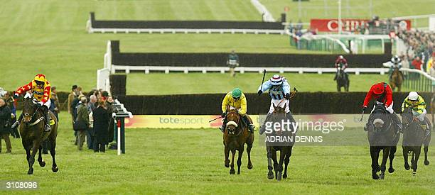 Sir Rembrandt ridden by Andrew Thornton is chased by eventual winner Jim Culloty riding Best Mate races up the final straight during The Cheltenham...