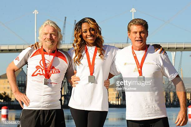 Sir Richard Branson Alexandra Burke and David Hasselhoff attend a photocall ahead of the Virgin Active London Triathlon at ExCel on September 22 2012...