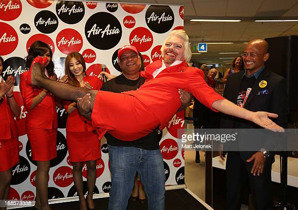 Sir Richard Branson and AirAsia CEO Tony Fernandes at Perth International Airport on May 12 2013 in Perth Australia Branson shaved his legs wore make...