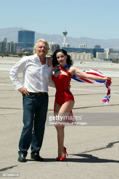 Sir Richard Branson and Dita Von Teese pose for photographers at McCarran International Airport Las Vegas USA to celebrate the 10th Anniversary of...