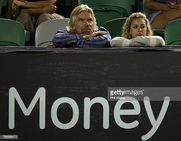 Sir Richard Branson and his daughter Holly Branson watch the third round match between Serena Williams of the USA and Nadia Petrova of Russia on day...