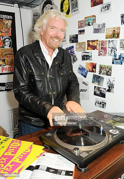 Sir Richard Branson attends a private view of the 'Virgin Records 40 Years Of Disruptions' exhibition at Victoria House on October 23 2013 in London...