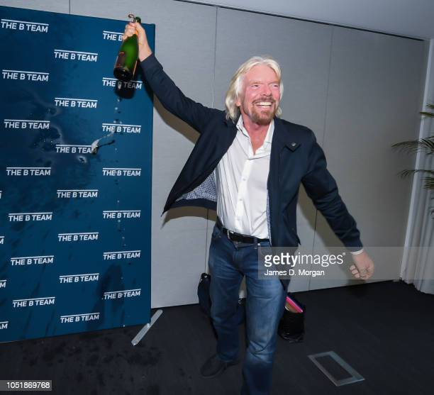 Sir Richard Branson celebrates with champagne during the launch of The B Team Australasia on October 11 2018 in Sydney Australia The B Team...