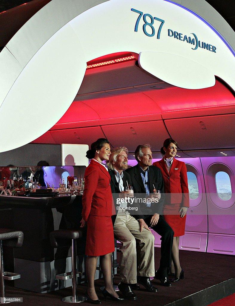 Sir Richard Branson, chairman of Virgin Group Ltd., left and : News Photo