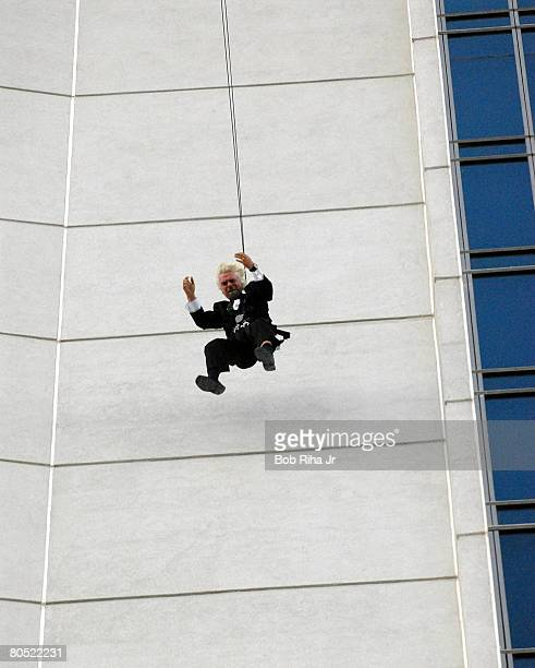 Sir Richard Branson descends 350 feet down the side of the Palms Casino Resort Fantasy Tower to promote the arrival of Virgin America first flights...