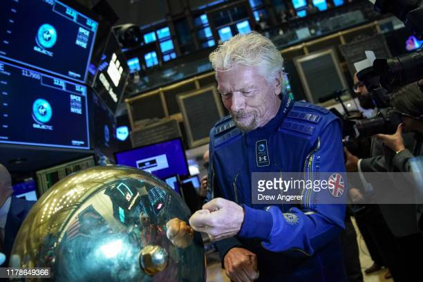 Sir Richard Branson, Founder of Virgin Galactic, arrives on the floor of the New York Stock Exchange before ringing a ceremonial bell to promote the...